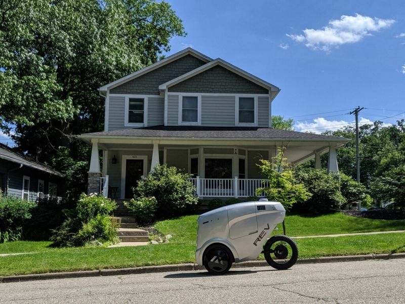 Customers of The Produce Station grocery store on South State Street in Ann Arbor can now have their items delivered by a REV-1 robot developed by Ref